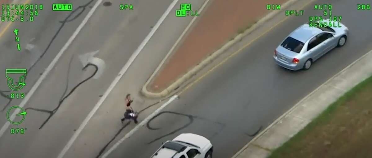 Authorities released video showing a woman driving an SUV speeding away from police stop, swerving in and out of traffic until she crashes. Then pulling a baby out of vehicle and runs off. (Sept. 3)