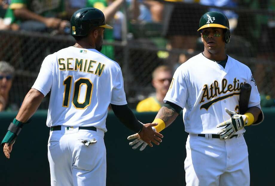 OAKLAND, CA - SEPTEMBER 03:  Marcus Semien #10 of the Oakland Athletics is congratulated by Khris Davis after Semien scored against the New York Yankees in the bottom of the fourth inning at Oakland Alameda Coliseum on September 3, 2018 in Oakland, California.  (Photo by Thearon W. Henderson/Getty Images) Photo: Thearon W. Henderson / Getty Images