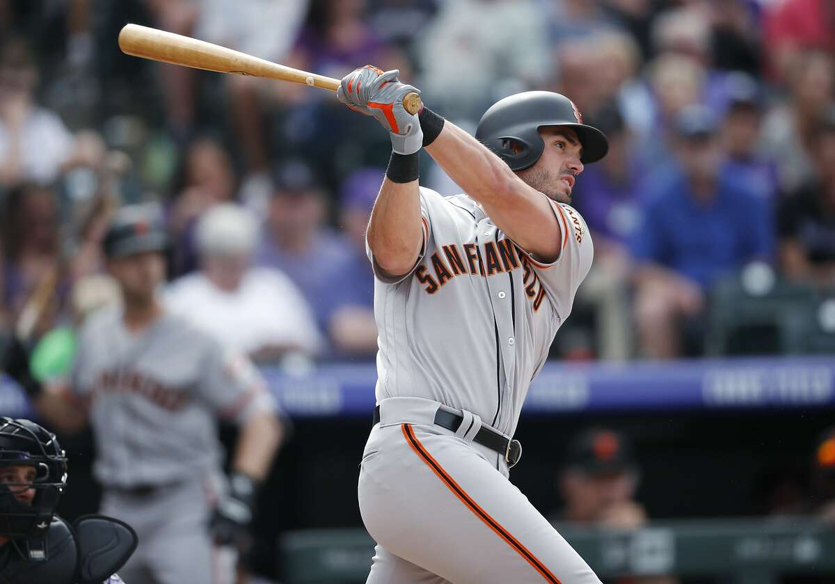 San Francisco Giants pinch-hitter Chris Shaw follows the flight of his solo home run off Colorado Rockies relief pitcher Seunghwan Oh in the eighth inning of a baseball game Monday, Sept. 3, 2018, in Denver. (AP Photo/David Zalubowski)