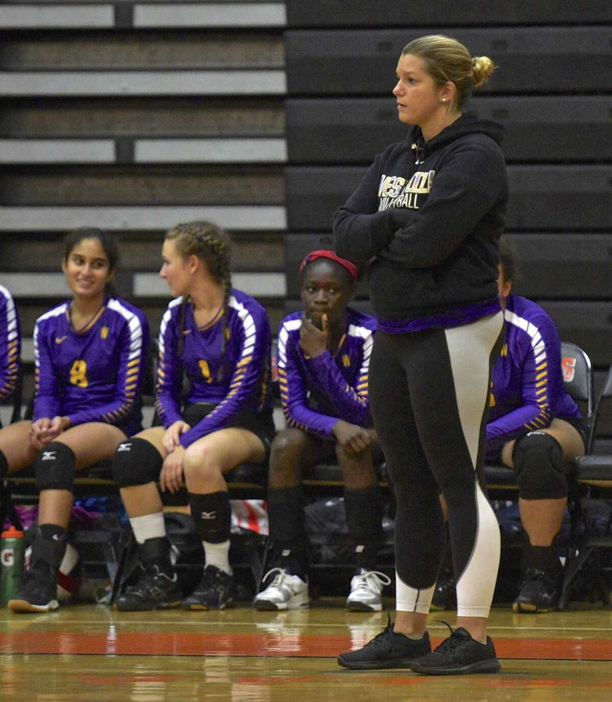 Westhill head coach Marianna Capomolla watches her team in the girls volleyball game between Westhill and Ridgefield high schools on Oct. 25, 2017, at Ridgefield High School, in Ridgefield, Conn.
