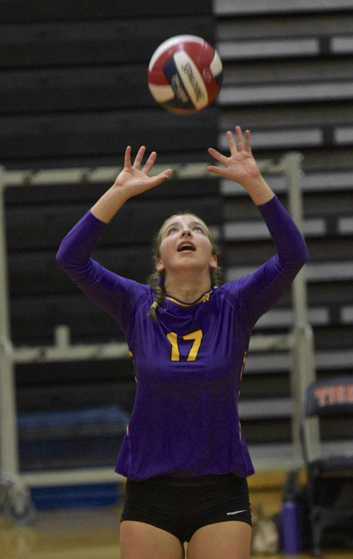 Westhill's Sophia Thagouras sets the ball in the girls volleyball game between Westhill and Ridgefield high schools on Oct. 25, 2017, at Ridgefield High School, in Ridgefield, Conn.