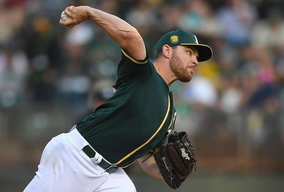 OAKLAND, CA - SEPTEMBER 01: Liam Hendriks #16 of the Oakland Athletics pitches against the Seattle Mariners in the top of the second inning at Oakland Alameda Coliseum on September 1, 2018 in Oakland, California. (Photo by Thearon W. Henderson/Getty Images) Photo: Thearon W. Henderson / Getty Images