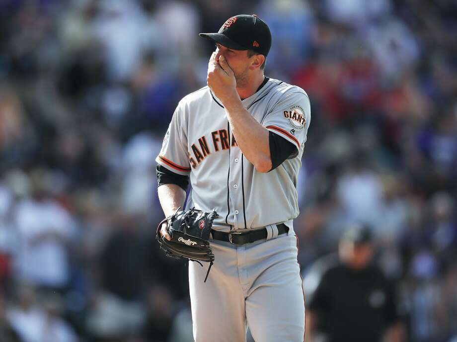 San Francisco Giants relief pitcher Tony Watson reacts after giving up a pinch-hit single to Colorado Rockies' Noel Cuevas to allow in the tying and go-ahead runs in the eighth inning of a baseball game Monday, Sept. 3, 2018, in Denver. (AP Photo/David Zalubowski) Photo: David Zalubowski / Associated Press