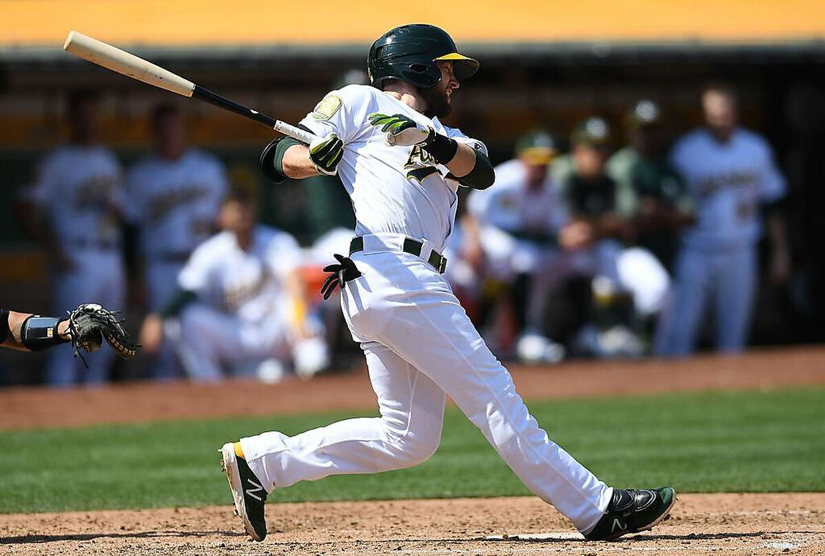 OAKLAND, CA - SEPTEMBER 03: Jed Lowrie #8 of the Oakland Athletics hits an rbi single scoring Marcus Semien #10 against the New York Yankees in the bottom of the fourth inning at Oakland Alameda Coliseum on September 3, 2018 in Oakland, California. Lowrie hit a walkoff homerun to give the A's a 5-4 victory over the Cleveland Indians on Friday night. (Photo by Thearon W. Henderson/Getty Images)