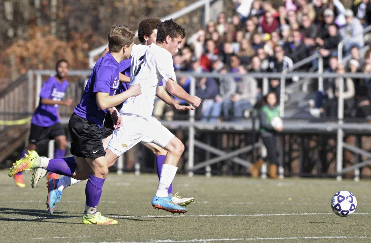 Brookfield's David Walker (3) our races Ellington's James Maznicki (17) and Roman Dutkewych (13) to the ball in the boys Class M state soccer championship game between Ellington and Brookfield high schools. Saturday, November 19, 2016, on Ray Snyder Sr. Field, in Waterbury, Conn. Brookfield High School defeated Ellington High School 1-0 to win the State Championship in Class M boys soccer.