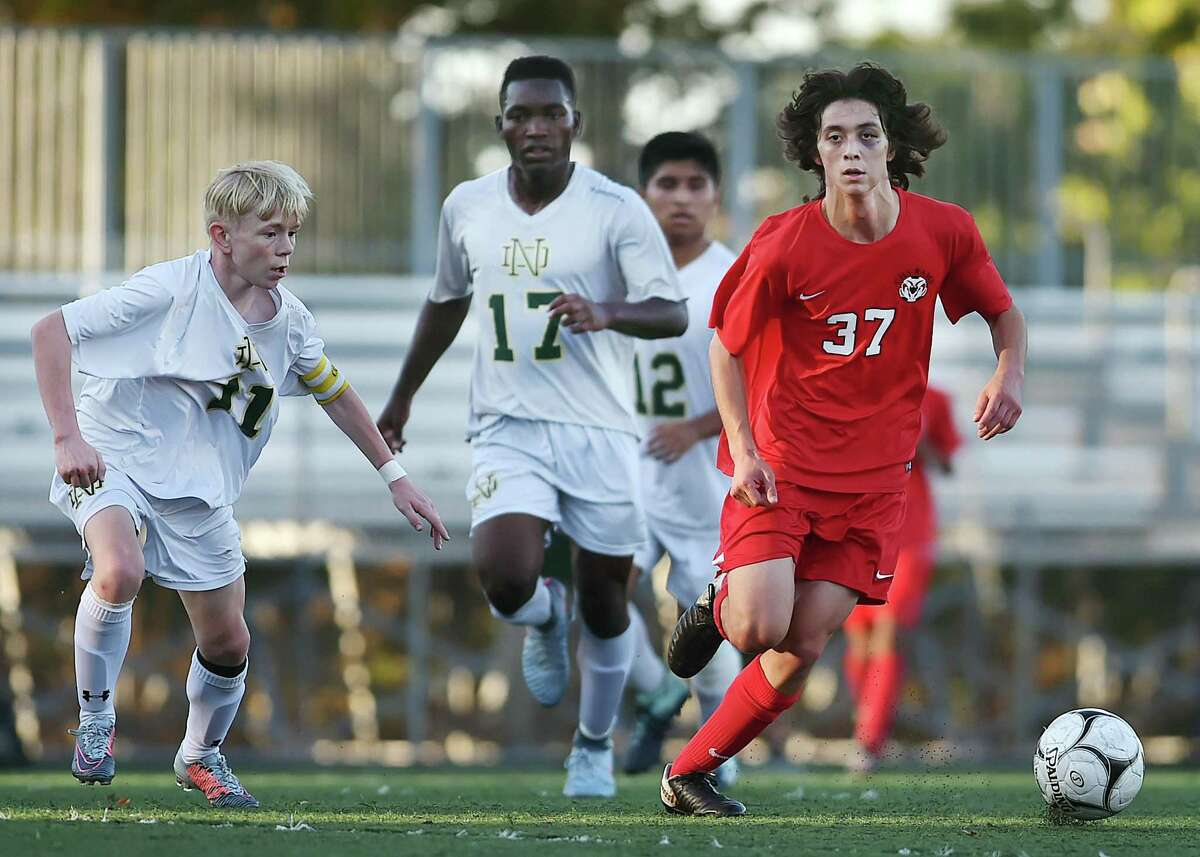 Cheshire junior midfield/forward Toby Goldstein controls the ball as Notre Dame-West Haven senior midfielder Christopher Seeland defends, Tuesday, Oct. 10, 2017, at Veterans Stadium in New Haven. Cheshire won, 2-1.