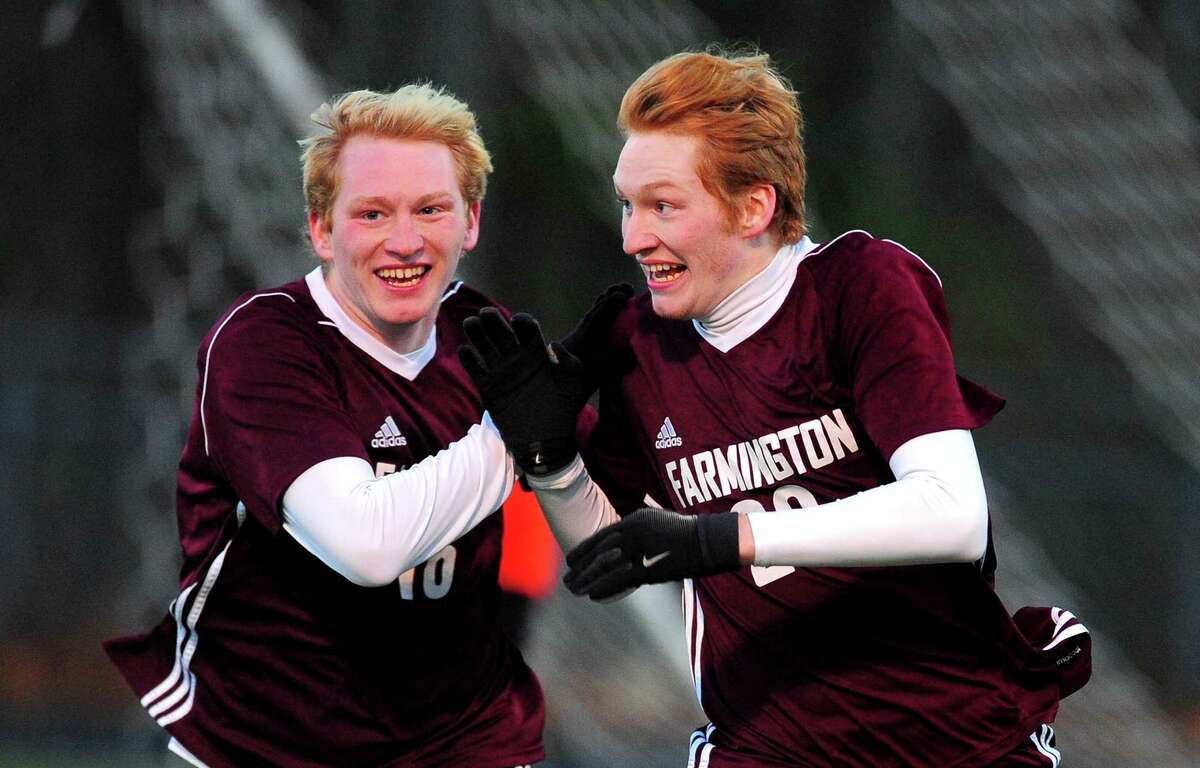 Farmington's Nate Hughes, right, celebrates a goal against Shelton with teammate Brennan Hughes during Class LL boys soccer state tournament action in Shelton, Conn., on Saturday Nov. 11, 2017.