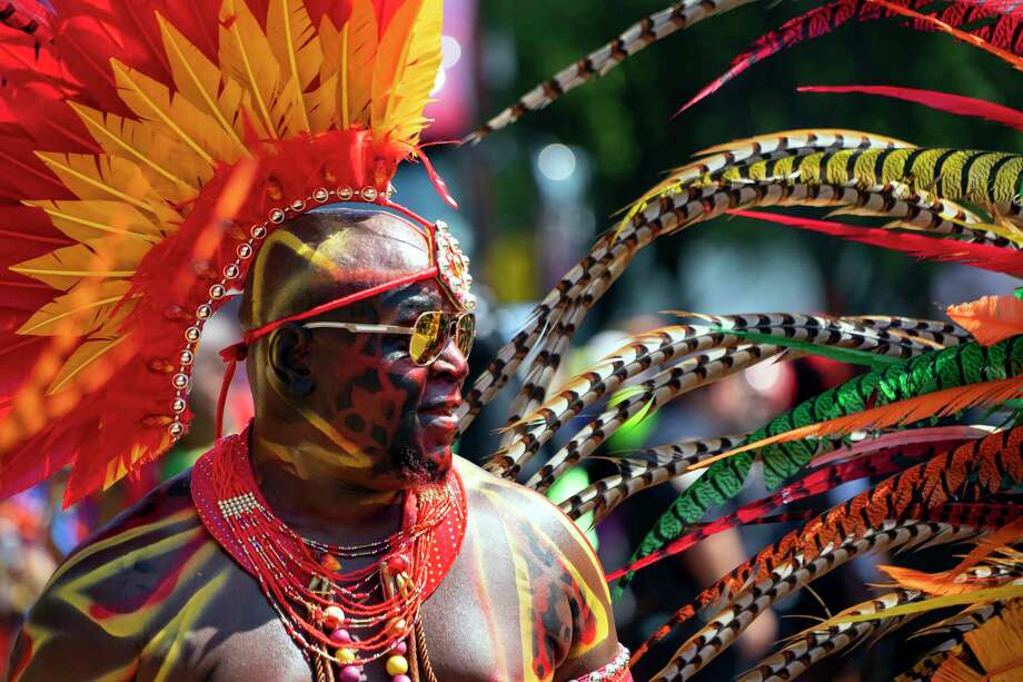 A person in masquerade participates in the West Indian American Day Parade in the Brooklyn borough of New York, Monday, Sept. 3, 2018. Revelers displaying Caribbean pride took to the streets of Brooklyn on Monday, flags waving, music blaring and feet dancing, for New York City's annual take on Carnival celebrations. (AP Photo/Craig Ruttle) Photo: Craig Ruttle / FR61802 AP