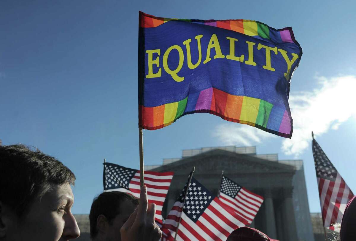 Same-sex marriage supporters demonstrate in front of the Supreme Court on March 27, 2013 in Washington, DC. AFP PHOTO/Jewel Samad