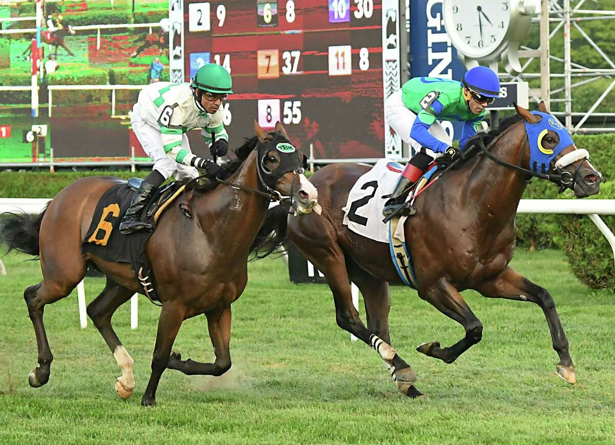 Bootlegger, #2, ridden by jockey Luis Reyes had a lead from the beginning and won the eighth race at Saratoga Race Course on Monday, Sept. 3, 2018 in Saratoga Springs, N.Y. Pocket Player ridden by jockey Jose Lezcano crosses the finish line second. (Lori Van Buren/Times Union)