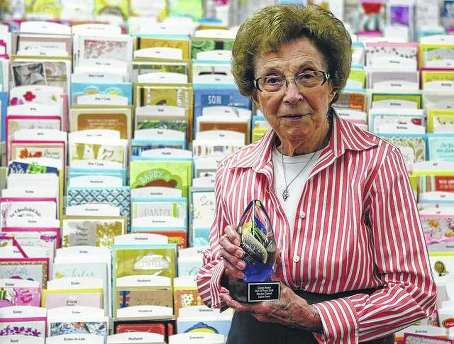 Carolyn Casteel shows her award from the Illinois Senior Hall of Fame. She was inducted this year. Photo: Audrey Clayton | Journal-Courier