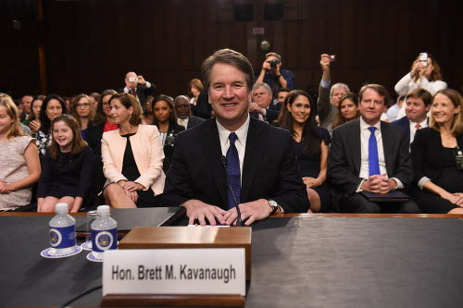 PHOTOS: A contentious hearingSupreme Court nominee Brett Kavanaugh arrives on the first day of his confirmation hearing Tuesday. 