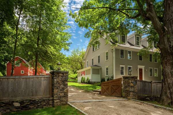 """The light gray colonial house at 400 Burr Street was built in 1764, ?""""before America was America,?"""" and it was updated to include modern day amenities."""