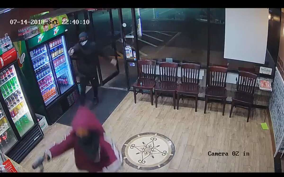 Three armed suspects ran into a Houston pizza parlor on July 14 and held at least two employees at gunpoint in the back of the store.