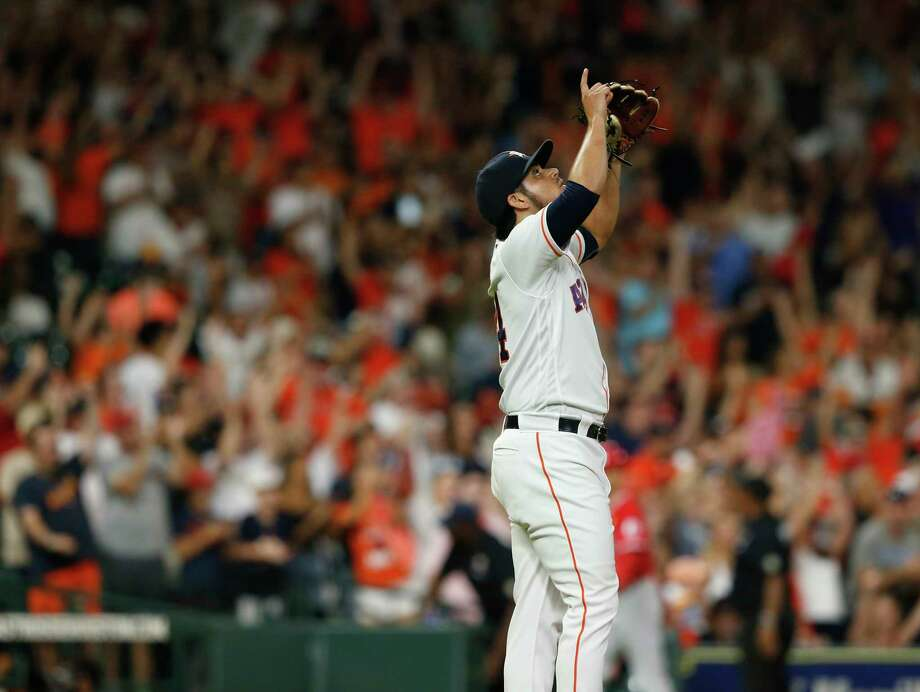 PHOTOS: What we know about Roberto Osuna HOUSTON, TX - SEPTEMBER 01: Roberto Osuna #54 of the Houston Astros points skyward after the game against the Los Angeles Angels of Anaheim at Minute Maid Park on September 1, 2018 in Houston, Texas. Photo: Getty Images / 2018 Getty Images