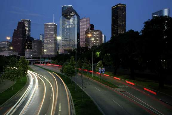 Motorists travel on Allen Parkway Friday, Aug. 31, 2018, in Houston.