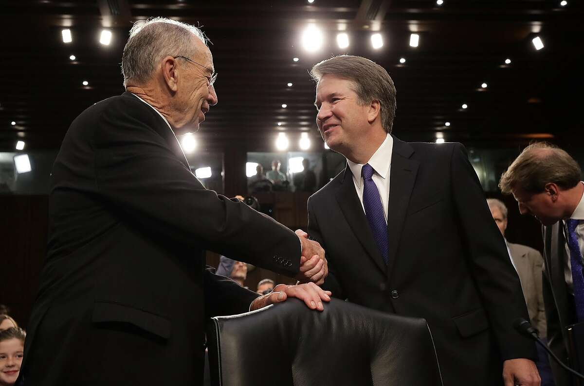 WASHINGTON, DC - SEPTEMBER 04: Supreme Court nominee Judge Brett Kavanaugh (R) is greeted by committee chairman Sen. Chuck Grassley (R-IA) as Kavanaugh arrives for testimony before the Senate Judiciary Committee during his Supreme Court confirmation hearing in the Hart Senate Office Building on Capitol Hill September 4, 2018 in Washington, DC. Kavanaugh was nominated by President Donald Trump to fill the vacancy on the court left by retiring Associate Justice Anthony Kennedy. (Photo by Drew Angerer/Getty Images)