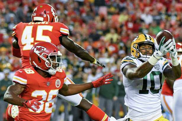Green Bay Packers wide receiver DeAngelo Yancey (10) catches a pass between Kansas City Chiefs defensive backs Ukeme Eligwe (45) and Arrion Springs (38) in the first inning during a preseason game on Thursday, Aug. 30, 2018, at Arrowhead Stadium in Kansas City, Mo.