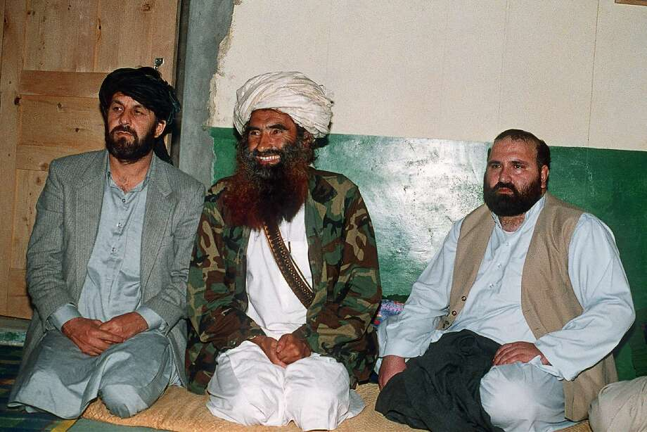 Jalaluddin Haqqani (center) sat between two of his top commanders in 1991 at his Pakistani base in Miranshah. His son Sirajuddin is the group's new leader. Photo: Zubair Mir / AFP / Getty Images 1991