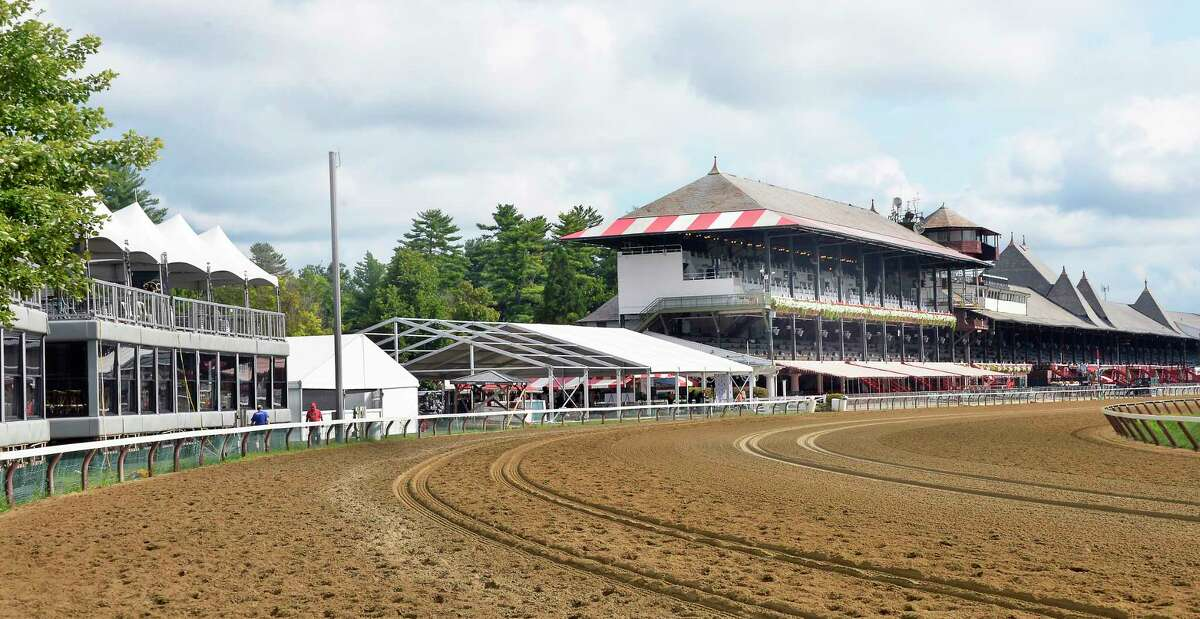 NYRA plans for their new 1863 Club that would replace the luxury boxes, left, and the At the Rail Pavilion, center, were announced at Saratoga Race Course Tuesday Sept. 4, 2018 in Saratoga Springs, NY. (John Carl D'Annibale/Times Union)