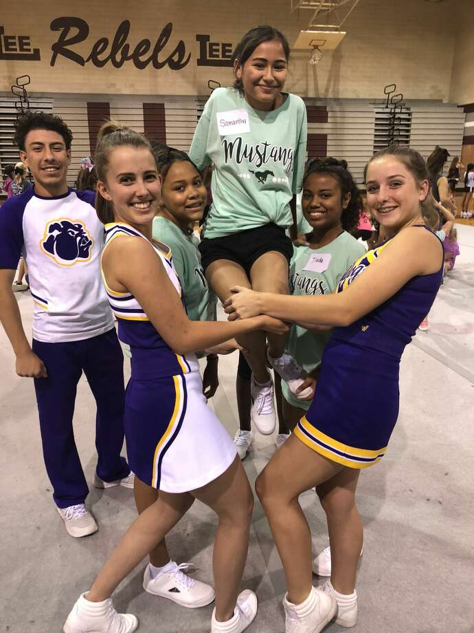 Cheer camp: Arnold Gallegos, from left, Reagan St..Peters, Kei'arah Rodgers, Samantha Rodriguez, Jhada Williams and Brianna Watson Photo: Courtesy Photo