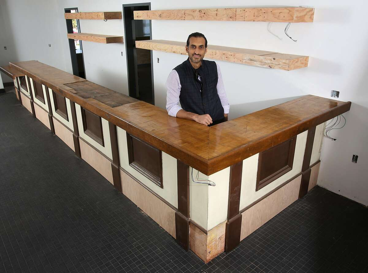 Bashar Sneeh photographed on Friday, 8/31, 2018 in Marina, California with the original bar from Fort Ord's Stilwell Hall that is being installed in his new Dametra restaurant which is still under construction.