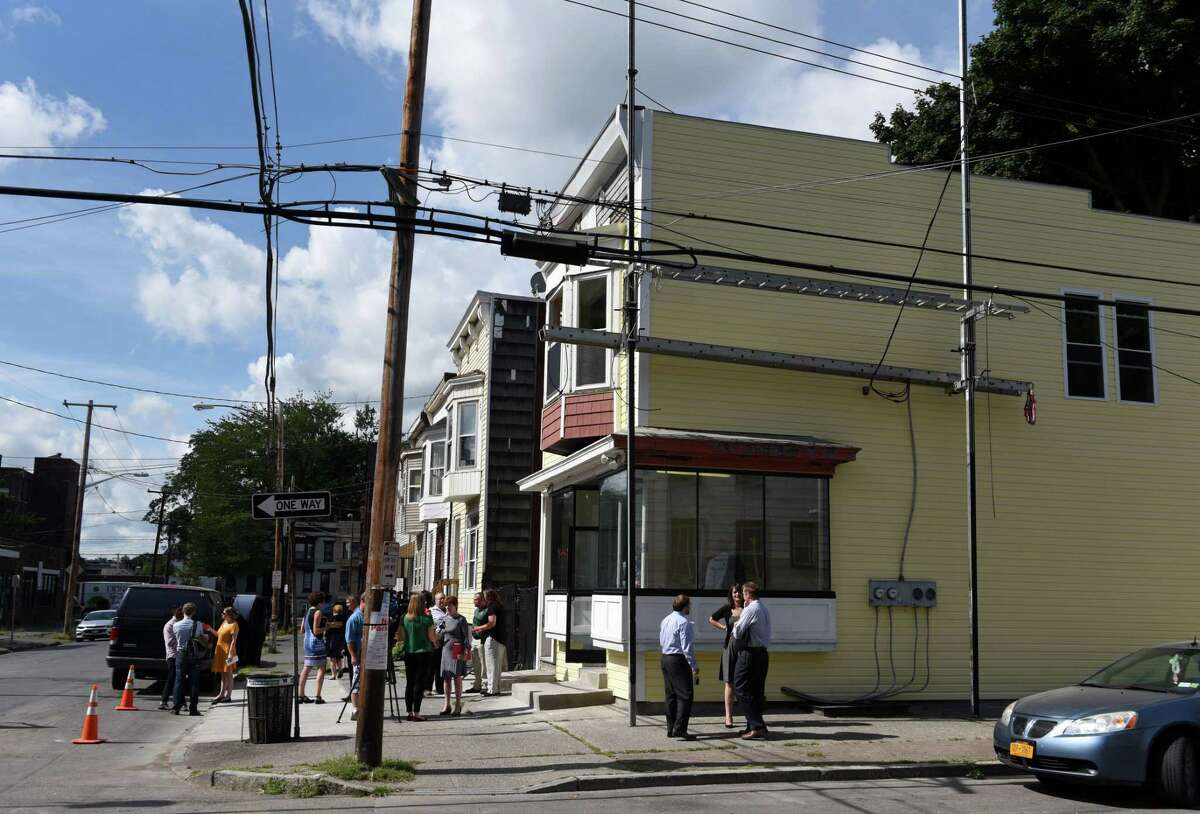 A press conference was held outside 16 Judson Street, where Dileep Rathore is transforming the former blighted property into a neighborhood grocery store on Tuesday, Sept. 4 2018, in Albany, N.Y. (Will Waldron/Times Union)