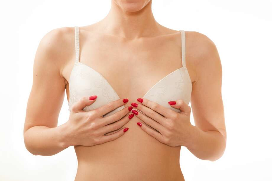 A woman want to tell her boyfriend about her breast implants. Photo: Lekcej/Getty Images/iStockphoto