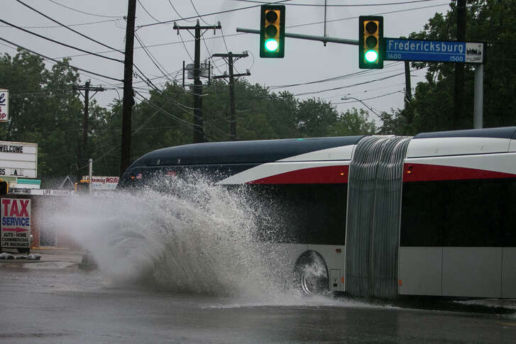A bus plows through water at the intersection of Fredricksberg and North Calaveras in San Antonio following heavy rains on Tuesday, Sept. 4, 2018.