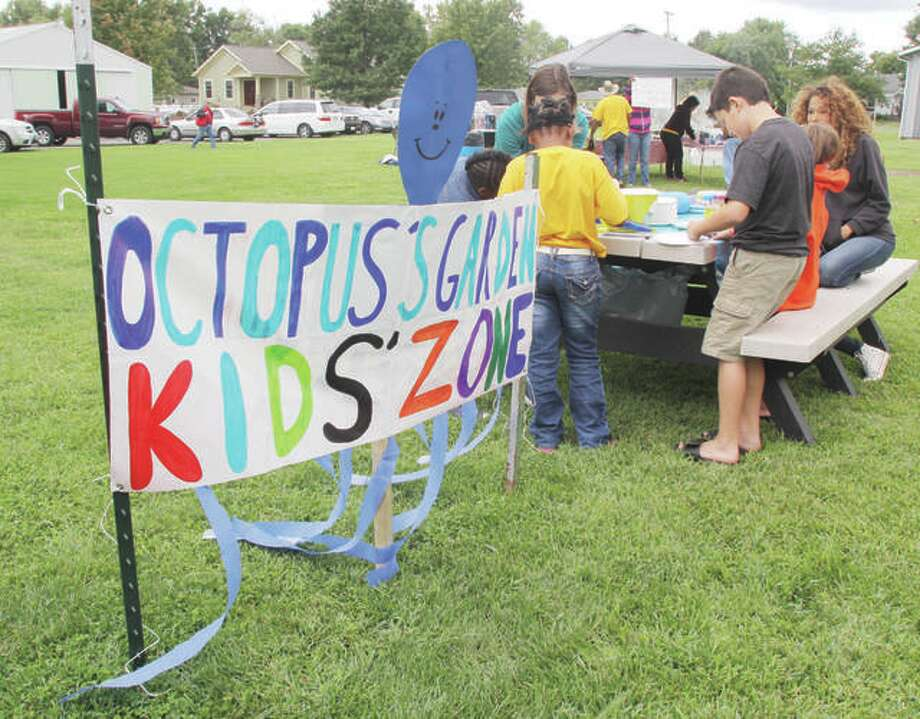 "In this 2015 photo, children play in the ""Octopus Garden"" at ""When I'm 64,"" an all-day Beatles festival held at Prairietown Fireman's Park in Prairietown. This year's event will be held on Sept. 8. Photo: Scott Cousins 