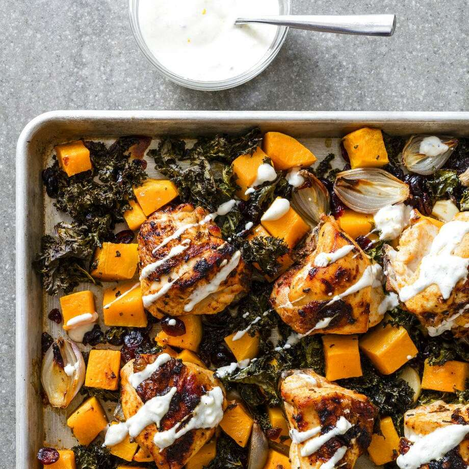 "This undated photo provided by America's Test Kitchen in August 2018 shows one-pan chicken with kale and butternut squash in Brookline, Mass. This recipe appears in the cookbook ""Nutritious Delicious."" (Daniel J. van Ackere/America's Test Kitchen via AP) Photo: Daniel J. Van Ackere / AP / 2016, Boston Common Press, DBA America's Test Kitchen. All Rights Reserved."