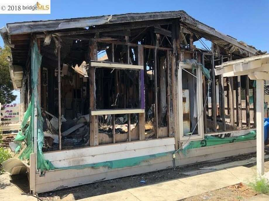 Burned out manufactured home in Oakland: yours for $350K Photo:  VINNY MANGUYEN • MICHAEL JAMES REAL ESTATE