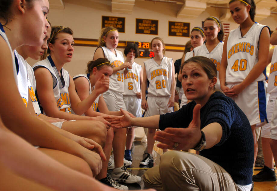 Midland High girls' basketball coach Elaine Mahabir exhorts her team during a 2008 district tournament game against Dow High. Photo: Daily News File Photo