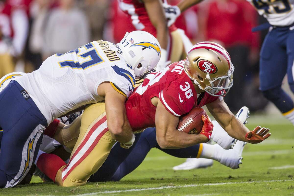 September 03, 2015: San Francisco 49ers KOR Jarryd Hayne (38) is tackled by San Diego Chargers linebacker Colton Underwood (57) during an NFL football game between the San Francisco 49ers and the San Diego Chargers at Levi's Stadium in Santa Clara, California, USA. (Photo by John Hefti/Icon Sportswire/Corbis via Getty Images)