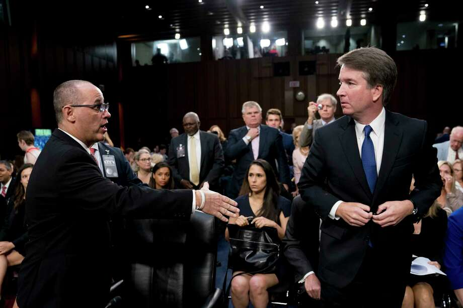 Fred Guttenberg, the father of Jamie Guttenberg who was killed in the Stoneman Douglas High School shooting in Parkland, Fla., left, attempts to shake hands with President Donald Trump's Supreme Court nominee, Brett Kavanaugh, right, as he leaves for a lunch break while appearing before the Senate Judiciary Committee on Capitol Hill in Washington, Tuesday, Sept. 4, 2018, to begin his confirmation to replace retired Justice Anthony Kennedy. Kavanaugh did not shake his hand. Photo: Andrew Harnik, AP / Copyright 2018 The Associated Press. All rights reserved