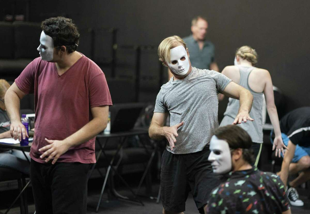 Actors rehearse the improvised pre-show for