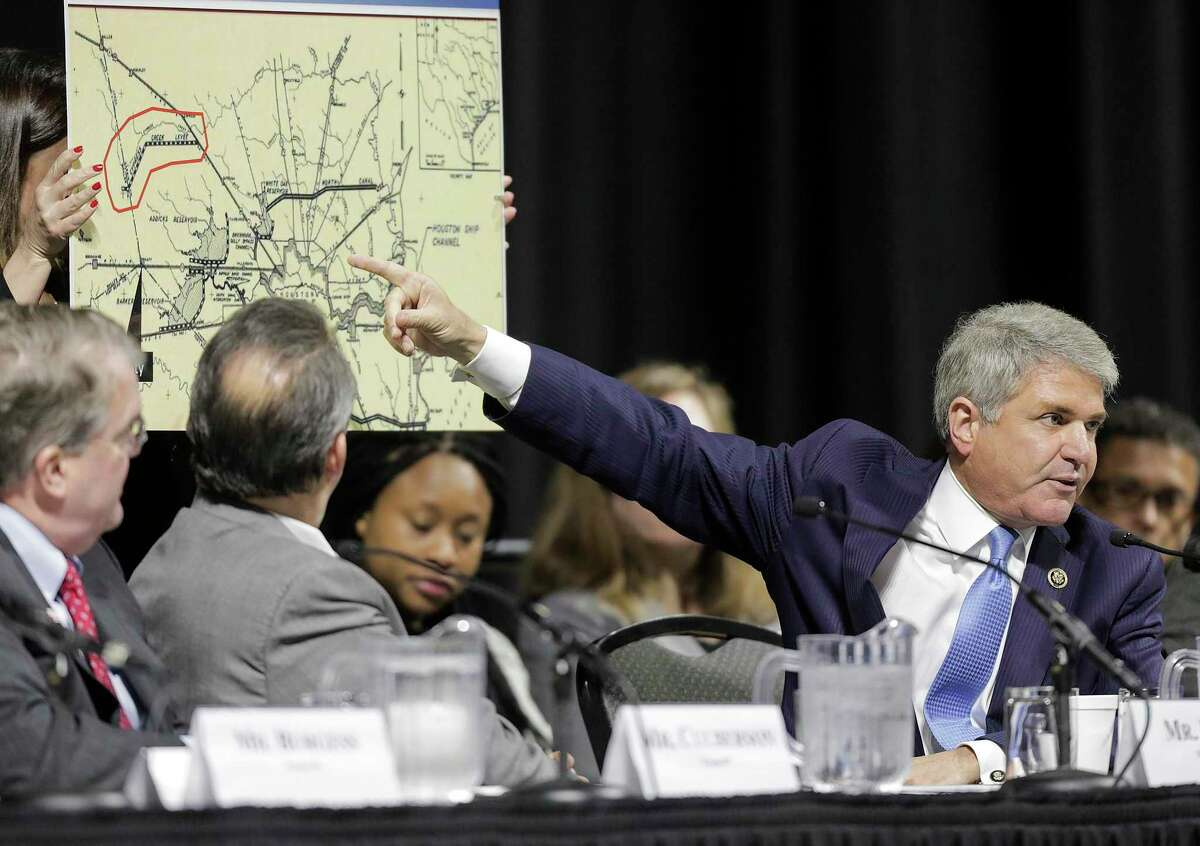 U.S. Rep. Michael McCaul (R-TX), Chairman of the House Committee on Homeland Security, points to a 1940 plan map during a hearing,