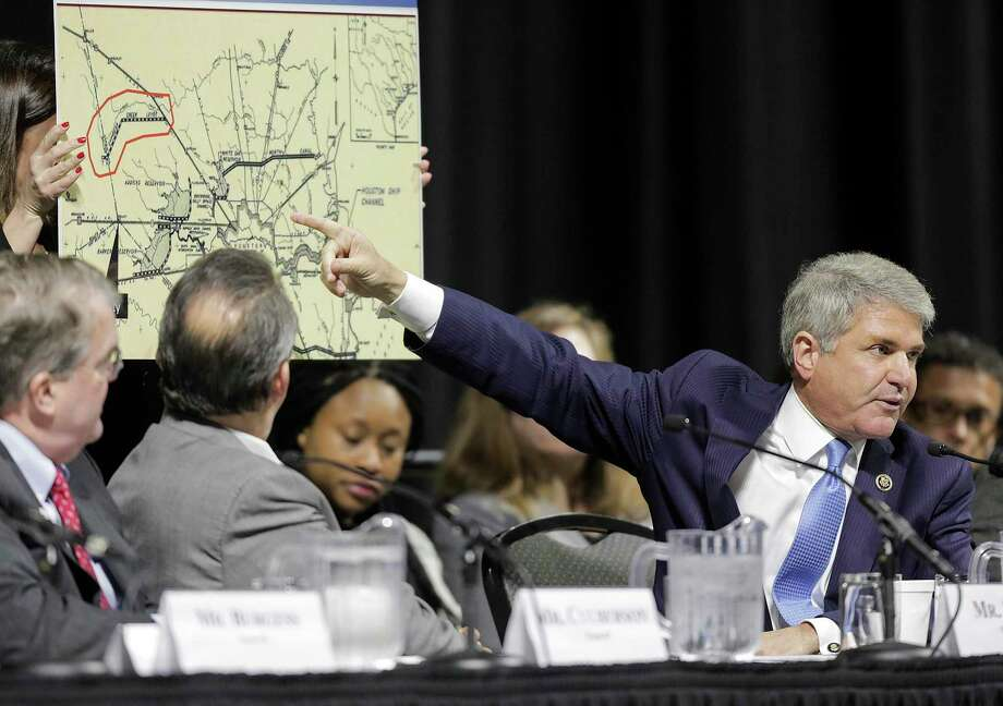 """U.S. Rep. Michael McCaul (R-TX), Chairman of the House Committee on Homeland Security, points to a 1940 plan map during a hearing, """"Houston Strong: Hurricane Harvey Lessons Learned and the Path Forward at Berry Hall on Monday, April 9, 2018, in Cypress. ( Elizabeth Conley / Houston Chronicle ) Photo: Elizabeth Conley, Chronicle / Houston Chronicle / © 2018 Houston Chronicle"""