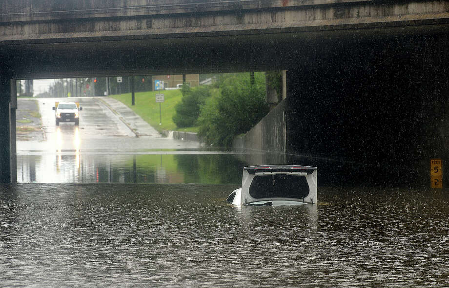 A car is submerged in high water at the Irving Street underpass beneath Martin Luther King, Jr. Blvd. in Beaumont. Heavy rainfall early Monday morning flooded several underpasses in the city and barricades remained in place throughout the afternoon as crews worked to clear debris when the water receded. Mark Rachal says he was heading to work around 6 a.m. when he got to the underpass. Being able to see the street and with a car moving through the standigng water just ahead of him, he felt it was safe to crive through, but his car began floating as soon as he got to the lowest point. Hours later, the vehicle was nearly submerged in close to 5 feet of water. Monday, September 03, 2018 Kim Brent/The Enterprise Photo: Kim Brent/The Enterprise