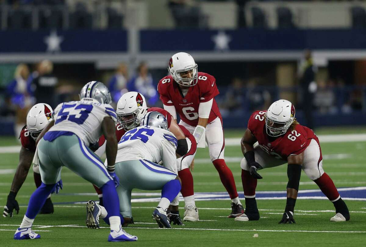Arizona Cardinals quarterback Charles Kanoff (6) and offensive lineman Daniel Munyer (62) prepare for the snap against the Dallas Cowboys during a preseason NFL football game in Arlington, Texas, Sunday, Aug. 26, 2018. (AP Photo/Roger Steinman)