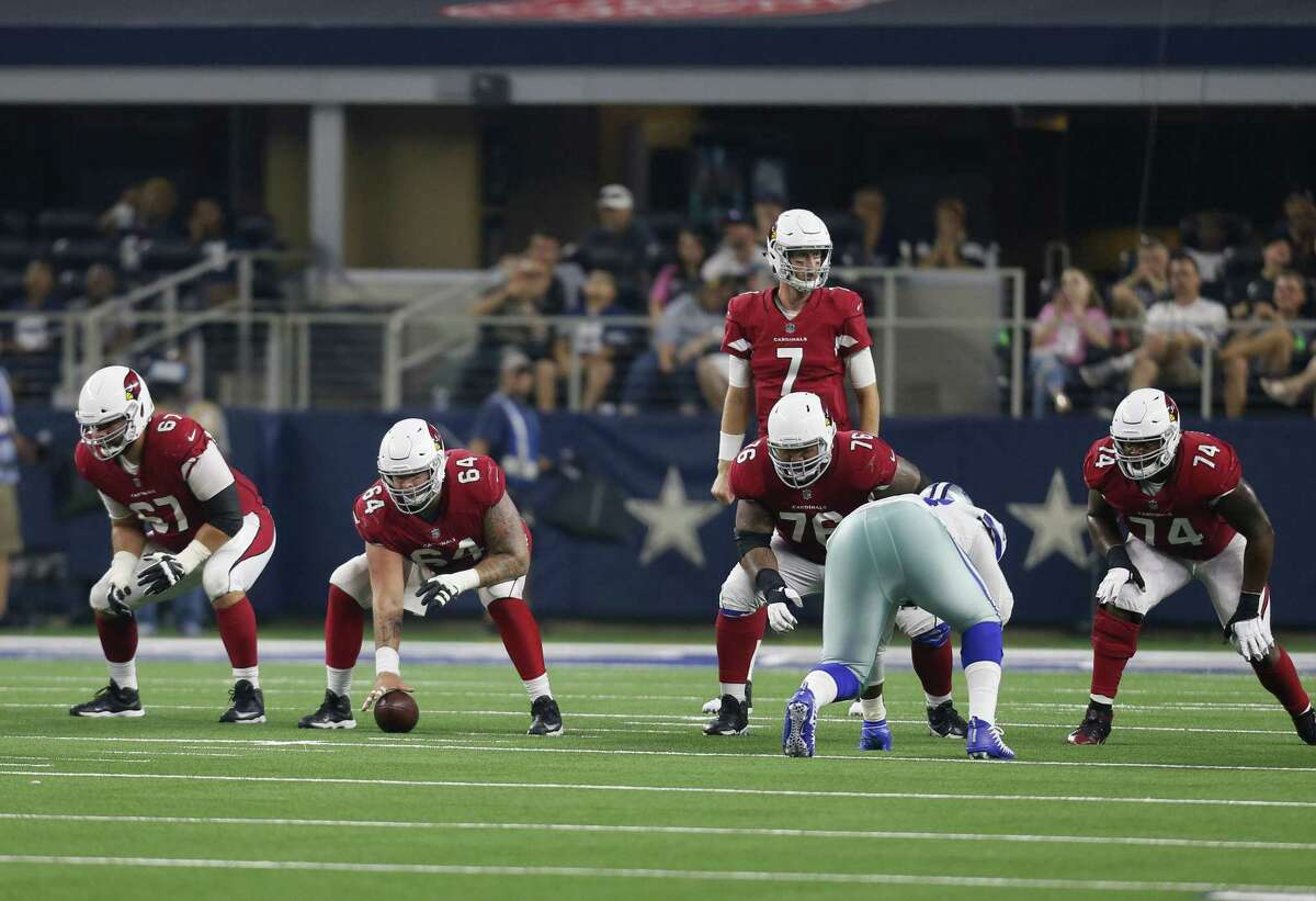Arizona Cardinals quarterback Mike Glennon (7) looks to the sideline as offensive linemen Justin Pugh (67), Mason Cole (64), Mike Iupati (76), and D.J. Humphries (74) wait for the snap during a preseason NFL football game against the Dallas Cowboys in Arlington, Texas, Sunday, Aug. 26, 2018. (AP Photo/Roger Steinman)