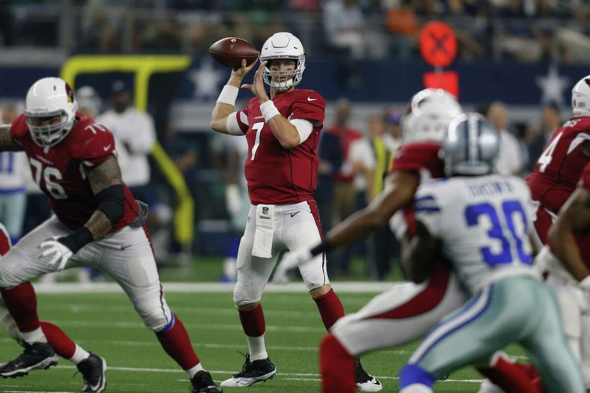 Arizona Cardinals quarterback Mike Glennon (center) prepares to pass against the Dallas Cowboys during a preseason NFL football game in Arlington, Texas, Sunday, Aug. 26, 2018. (AP Photo/Roger Steinman)