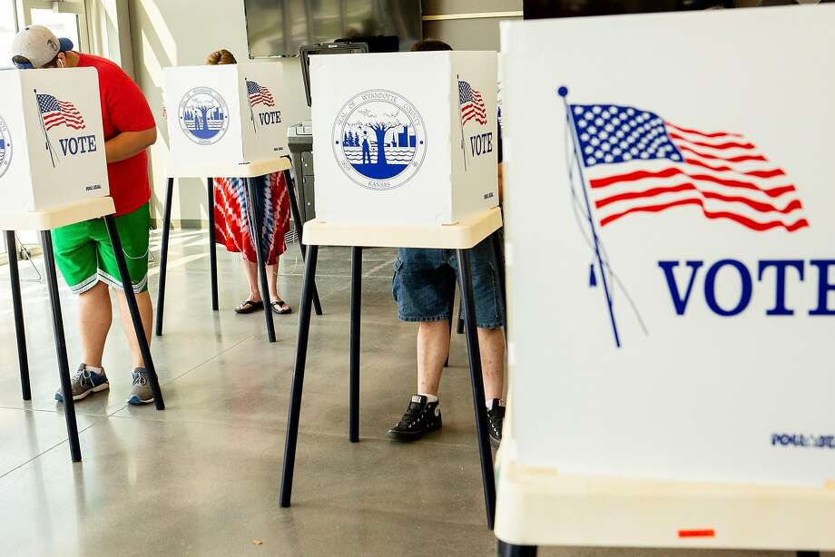 Voters cast ballots in a recent primary in Kansas City, Kan. A bipartisan bill was canceled by some Republican senators. Photo: Katie Currid / New York Times