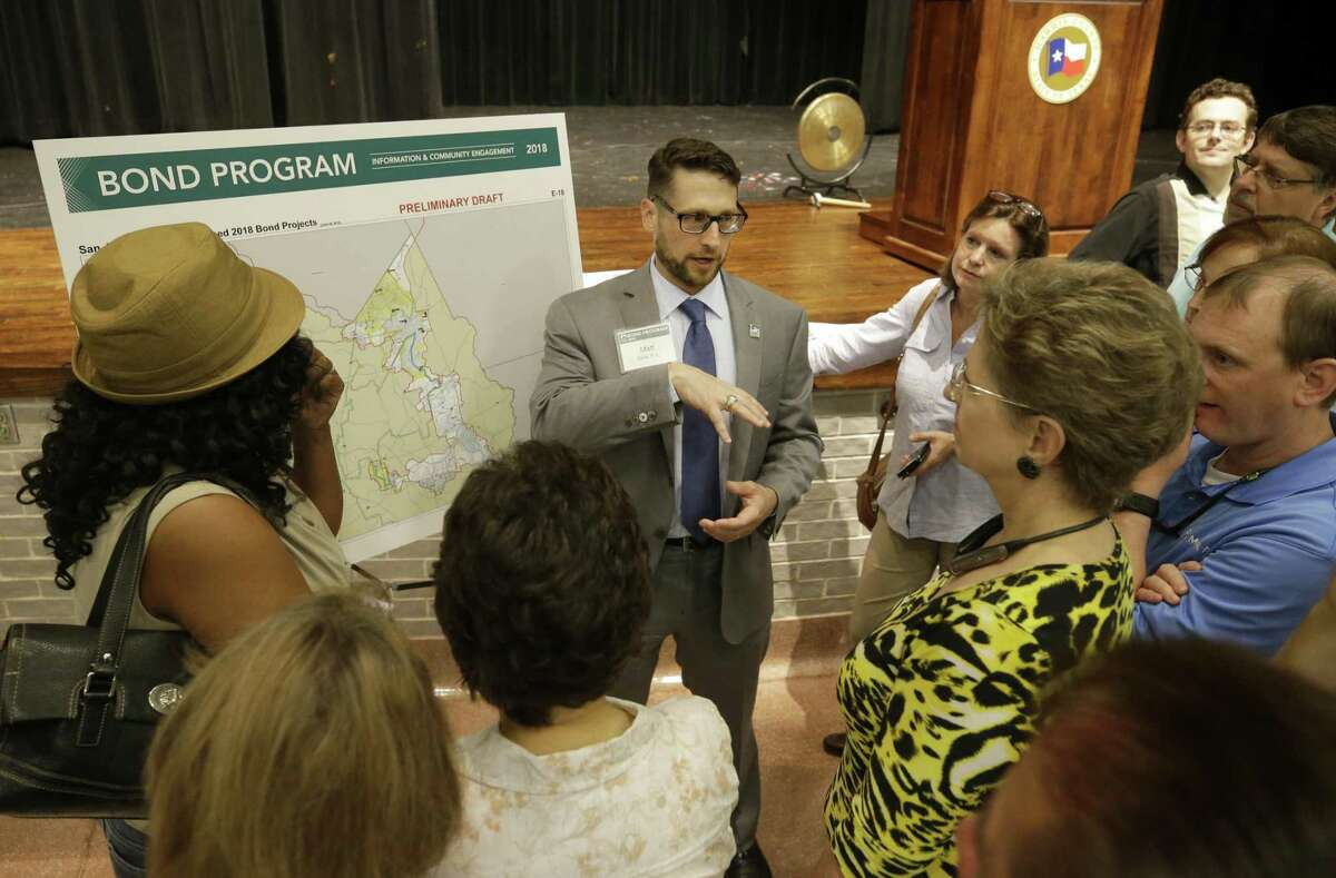 Matt Zeve, Harris County Flood Control District director of operations, speaks with people at the HCFCD bond program community meeting held at Kingwood Park High School, 4015 Woodland Hills Drive in Kingwood on Tuesday, July 10, 2018, in Houston.