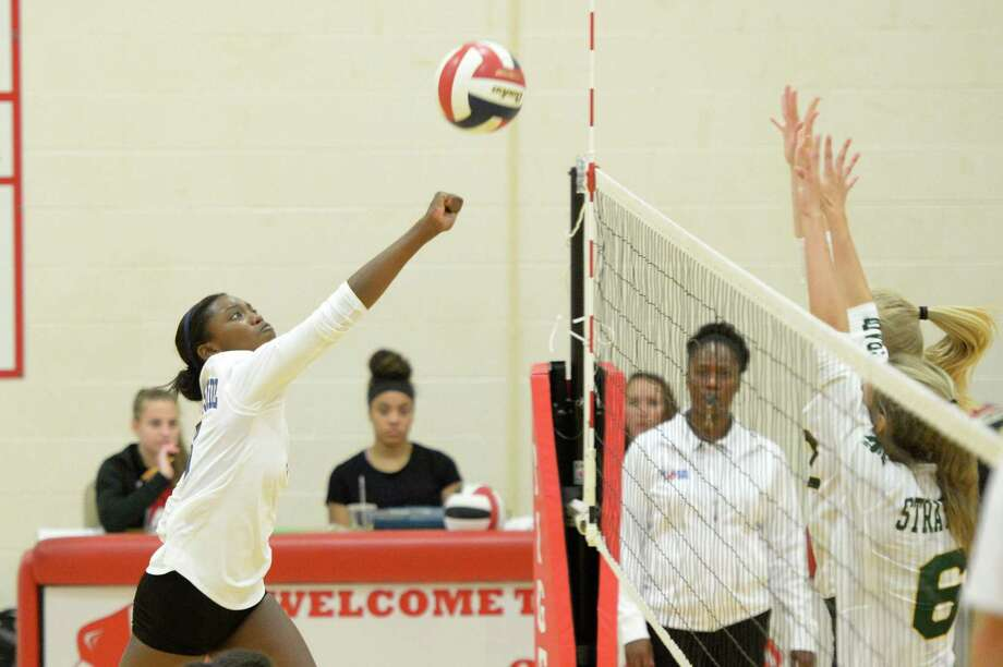 Kylah Carter (6) of Westside punches a shot over the net in the first set of a high school volleyball game between the Westside Wolves and the Stratford Spartans during the 2017 Cy-Fair ISD/Katy ISD Classic on August 12, 2017 at Katy High School, Katy, TX. Photo: Craig Moseley, Staff / Houston Chronicle / ©2017 Houston Chronicle