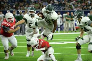 Dylan Campbell (23) of Strake Jesuit leaps for a gain to set-up a touchdown run on the next play in the fourth quarter of a high school football game between the Strake Jesuit Crusaders and the St. Thomas Eagles on Friday, August 31, 2018 at NRG Stadium, Houston, TX.
