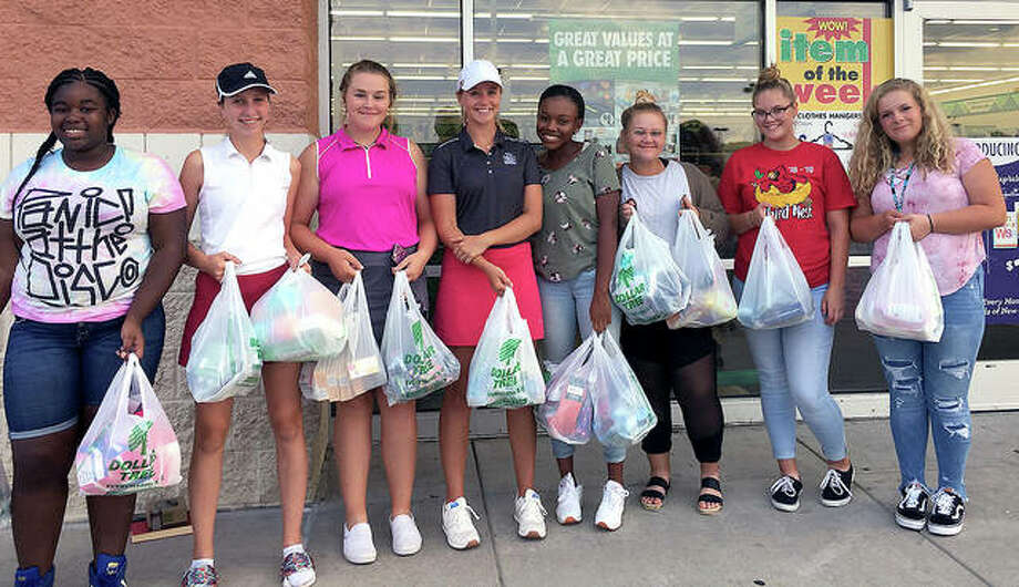 Members of the Alton High girls golf team with items purchased for distribution to the Alton School District Homeless Program. The team participated in 'Putt Fore a Purpose' fundraiser during the summer, during which money for those charity items, as well as team equipment and costs, was raised. Photo: Submitted Photo