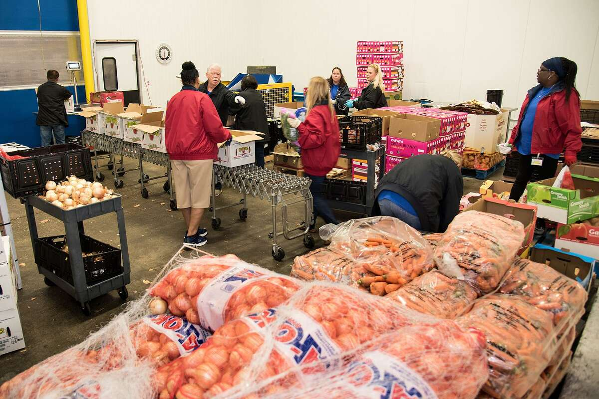 More than 160 volunteers repackaged 27,500 pounds of food at the Montgomery County Food Bank on Aug. 24 and 25.