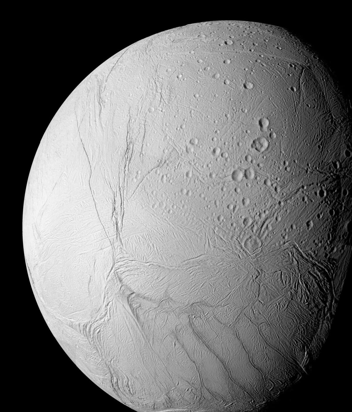 This photo provided by NASA shows the surface of Saturn's moon Enceladus in this photo taken by the Cassini spacecraft. Cassini has found evidence of liquid water spewing from geysers on Enceladus, raising the tantalizing possibility that the celestial object harbors life.