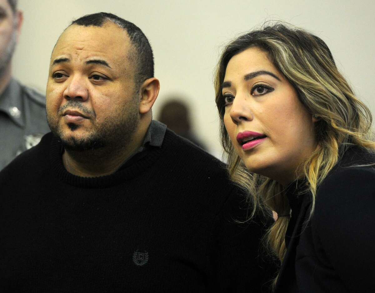 Oscar Hernandez, left, with the aid of a translator, faces Judge William Holden in Bridgeport Superior Court in April 2017. Hernandez is charged with murder, attempted murder, first-degree assault and risk of injury to a minor.